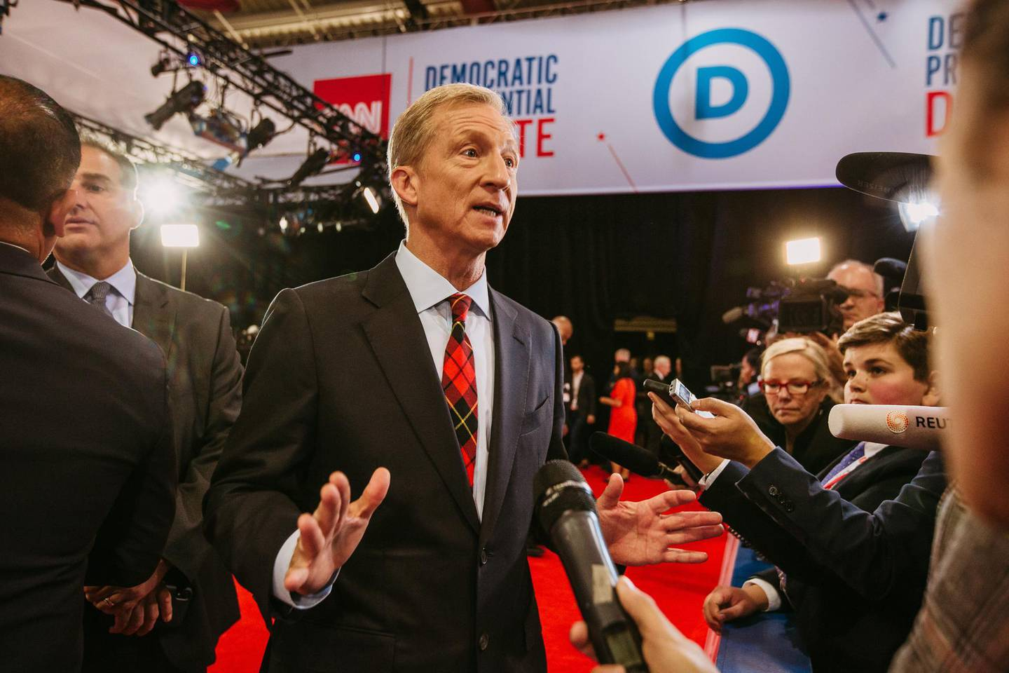 Tom Steyer, co-founder of NextGen Climate Action Committee and 2020 Democratic presidential candidate, speaks with members of the media in the spin room after the Democratic presidential candidate debate in Westerville, Ohio, U.S., on Tuesday, Oct. 15, 2019. Democratic presidential candidates vowed to rein in dominant tech companies through tougher antitrust enforcement, complaining that companies likeFacebook Inc.andAmazon.com Inc.are too big and powerful. Photographer: Allison Farrand/Bloomberg