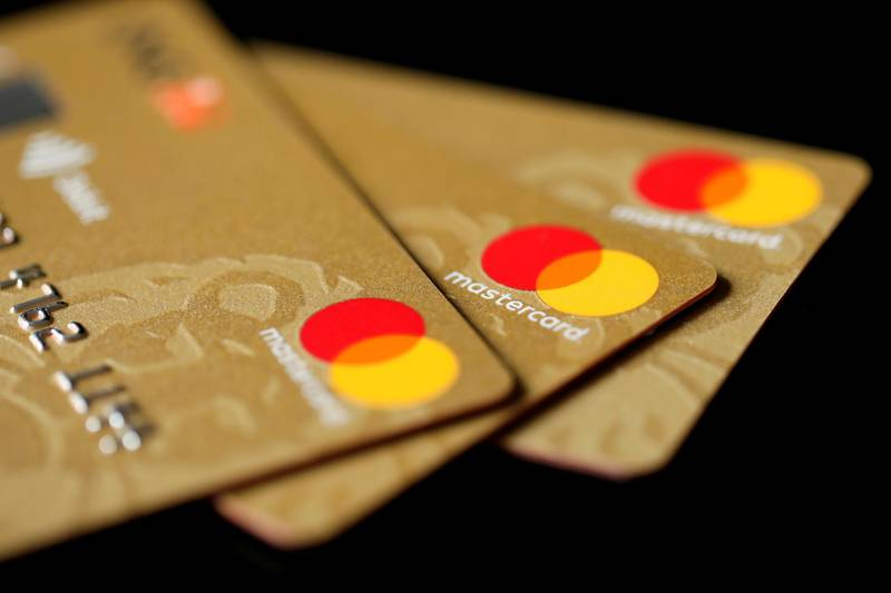 FILE PHOTO: Mastercard Inc. credit cards are displayed in this picture illustration taken December 8, 2017. REUTERS/Benoit Tessier/Illustration/File Photo