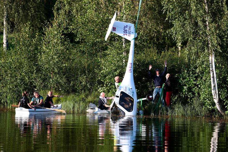 epa07773585 People effort to salvage the Avinor's electric aircraft a Pipistrel Alpha Electro flown by pilot Avinors CEO Dag Falk-Petersen and his passenger, secretary of state, Aase Marthe Johansen Horrigmo, which had to make an emergency landing in Nornestjoenn in Arendal, Norway, 14 August 2019. Both passenger and pilot came from the incident without injuries.  EPA/HAKON MOSVOLD LARSEN  NORWAY OUT