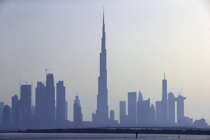 The Burj Khalifa skyscraper, center, stands above other skyscrapers on the city skyline in Dubai, United Arab Emirates. Photographer: Christopher Pike/Bloomberg