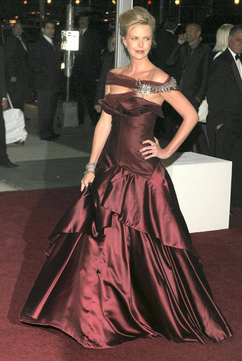 """NEW YORK - MAY 01:  Actress Charlize Theron attends the Metropolitan Museum of Art Costume Institute Benefit Gala """"AngloMania: Tradition and Transgression in British Fashion"""" at the Metropolitan Museum of Art on May 1, 2006 in New York City.  (Photo by Peter Kramer/Getty Images) *** Local Caption *** Charlize Theron"""