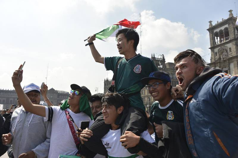 Mexico fans celebrate at the end of the World Cup group F match between Germany and South Korea, at a public event at the Zocalo Square in Mexico City, on June 27, 2018. / AFP / JOHAN ORDONEZ