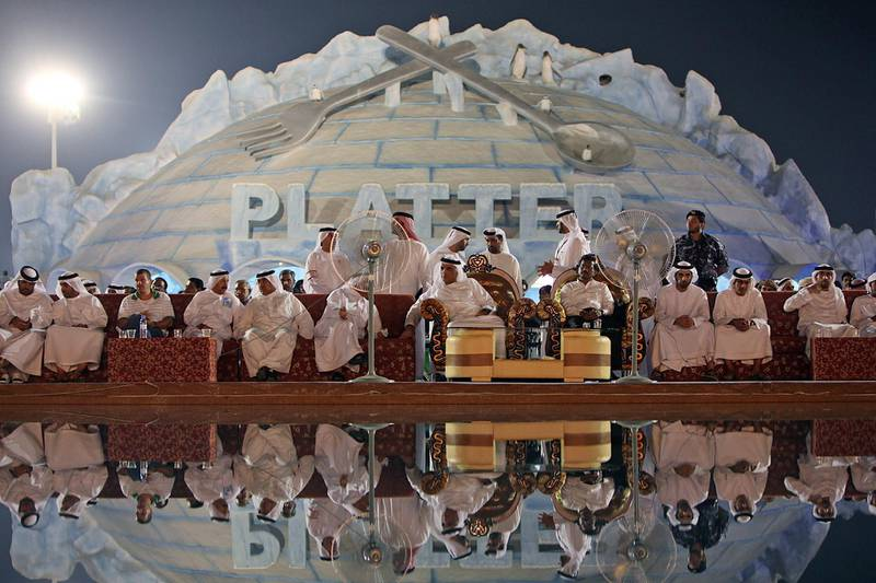 United Arab Emirates - Ras Al Khaimah - September 29, 2010.  NATIONAL: Crown prince and ruler, H. H. Sheikh Saud Bin Saqr Al Qasimi, center, watches the ceremonies at Ice Land Water Park during its grand public opening in Ras Al Khaimah on Wednesday, September 29, 2010. Amy Leang/The National