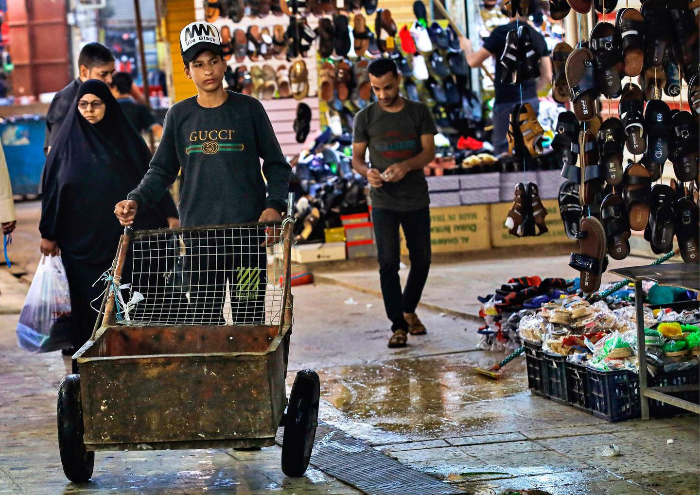 People shop at old Basra market, Iraq, Wednesday, Oct. 21, 2020.  Iraq is in the throes of an unprecedented liquidity crisis, as the cash-strapped state wrestles to pay public sector salaries and import essential goods while oil prices remain dangerously low. (AP Photo/Nabil al-Jurani)