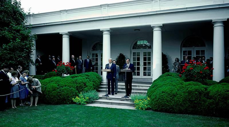 Russian President Boris Nikolaevich Yeltsin (1931 - 2007), left, stands next to US President George HW Bush (1924 - 2018) at the White House's Rose Garden, Washington, DC, June 16, 1992. (Photo by Mark Reinstein/Corbis via Getty Images)
