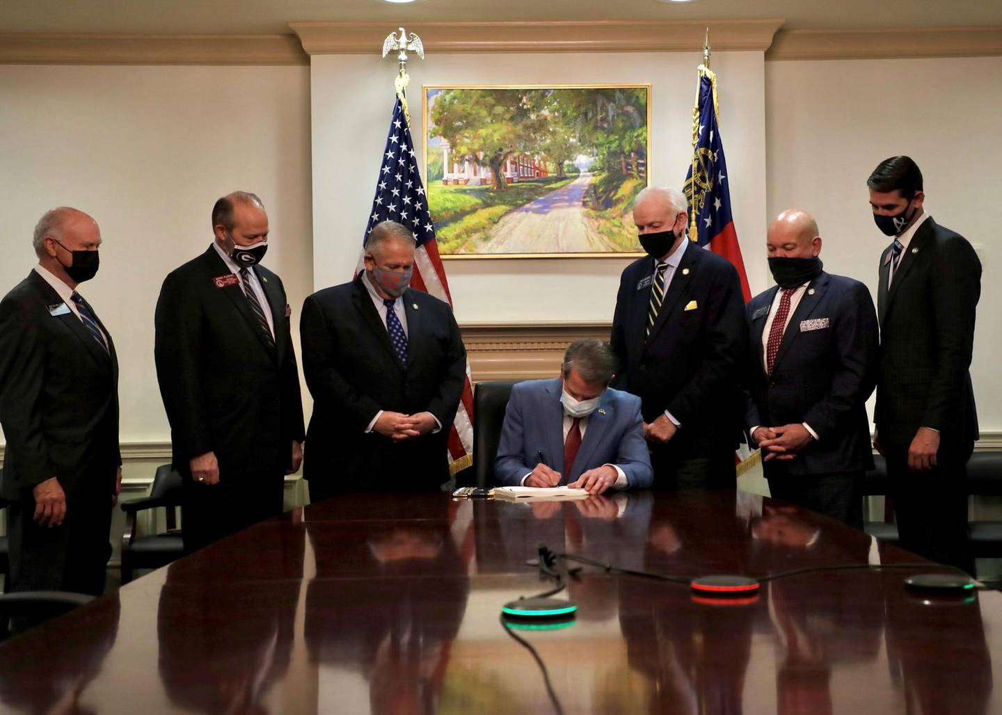 Republican Governor Brian Kemp signs the law S.B. 202, a restrictive voting law that activists have said aimed to curtail the influence of Black voters who were instrumental in state elections that helped Democrats win the White House and narrow control of the U.S. Senate, in this handout photo posted to Kemp's Twitter feed on March 25, 2021. Governor Brian Kemp's Twitter feed/Handout via REUTERS  THIS IMAGE HAS BEEN SUPPLIED BY A THIRD PARTY.