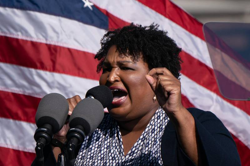 Former US Representative and voting rights activist Stacey Abrams speaks at a Get Out the Vote rally with former US President Barack Obama as he campaigns for Democratic presidential candidate former Vice President Joe Biden on November 2, 2020, in Atlanta, Georgia. / AFP / Elijah Nouvelage