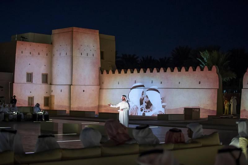 AL AIN, ABU DHABI, UNITED ARAB EMIRATES - November 15, 2015: Saif Al Mansouri recites a poem during the reopening of Qasr Al Muwaiji, in Al Ain.   ( Mohamed Al Hammadi / Crown Prince Court - Abu Dhabi ) --- *** Local Caption ***  20151115MH0C078620.JPG