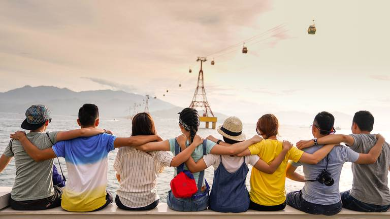 An image that illustrates this article Do you need lots of friends to be happy? Why the optimum number is less than you think