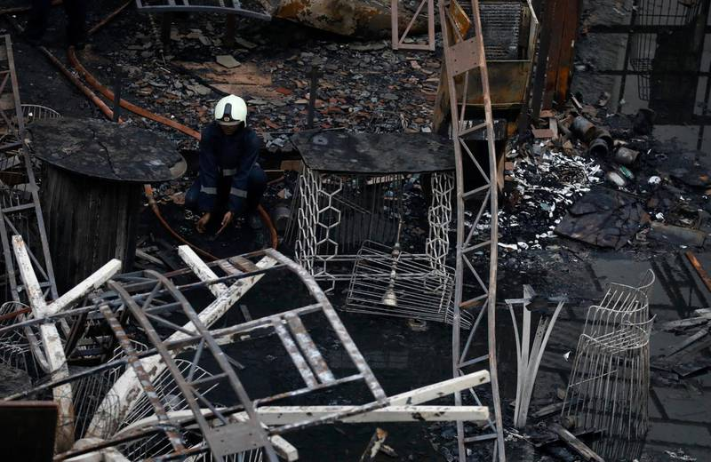 REFILE - CORRECTING DATE A fire fighter rests amidst debris at a restaurant destroyed in a fire in Mumbai, India, December 29, 2017. REUTERS/Danish Siddiqui