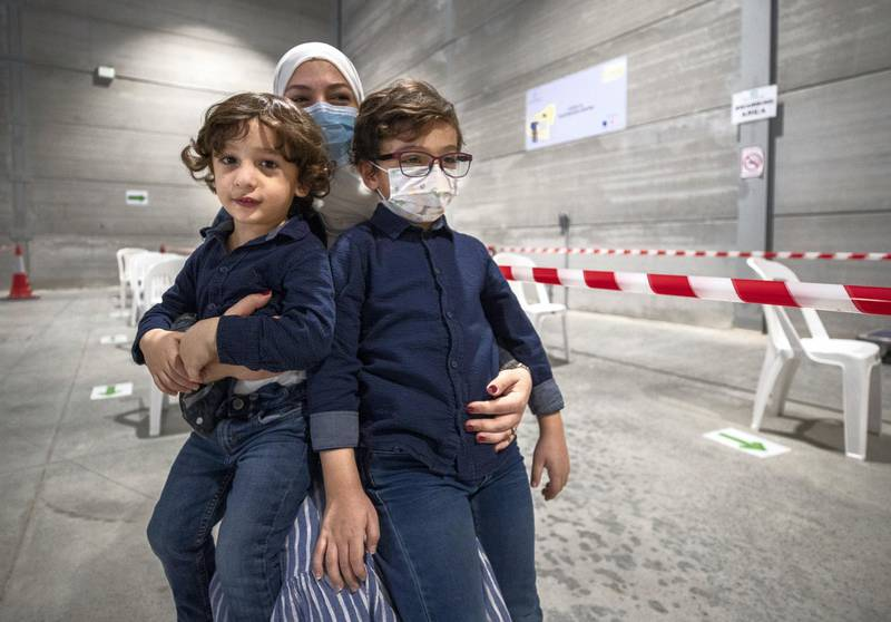 Abu Dhabi, United Arab Emirates, March 18, 2021.  A mother takes her children, Ryan Al Mulla, 6 and Omar, three years old, to get saliva tested at the Biogenix lab at G42 in Masdar City. Victor Besa/The NationalSection:  NAReporter:  Shireena Al Nowais