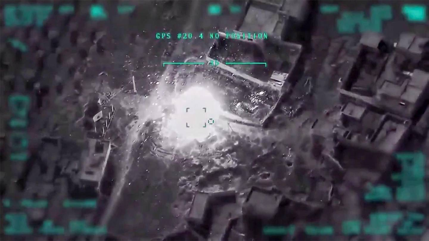 """TOPSHOT - An image grab taken from a video released on March 1, 2020, by the Turkish Defence Ministry shows an airstrike by the Turkish military on Syrian regime positions. Syria's army Sunday downed a Turkish drone over northwest Syria after it threatened """"enemy"""" aircraft violating its airspace over deadly Turkish drone strikes, state media said. State news agency SANA said the unmanned aircraft was shot down near the town of Saraqeb, publishing footage of the alleged plane tumbling down from the skies in flames. - RESTRICTED TO EDITORIAL USE - MANDATORY CREDIT """"AFP PHOTO /TURKISH DEFENCE MINISTRY """" - NO MARKETING - NO ADVERTISING CAMPAIGNS - DISTRIBUTED AS A SERVICE TO CLIENTS  / AFP / TURKISH DEFENCE MINISTRY / Handout / RESTRICTED TO EDITORIAL USE - MANDATORY CREDIT """"AFP PHOTO /TURKISH DEFENCE MINISTRY """" - NO MARKETING - NO ADVERTISING CAMPAIGNS - DISTRIBUTED AS A SERVICE TO CLIENTS"""