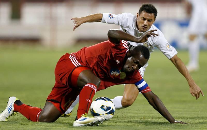 Diaky Ibrahim Amuah (L) of UAE's Al-Jazira fight for the ball with Qatar's El-Jaish Karim Ziani during their AFC Champions League soccer match at the Al-Rayyan Stadium in Doha April 2, 2013. REUTERS/Fadi Al-Assaad (QATAR - Tags: SPORT SOCCER) *** Local Caption ***  QAT01_SOCCER-ASIAN-_0402_11.JPG