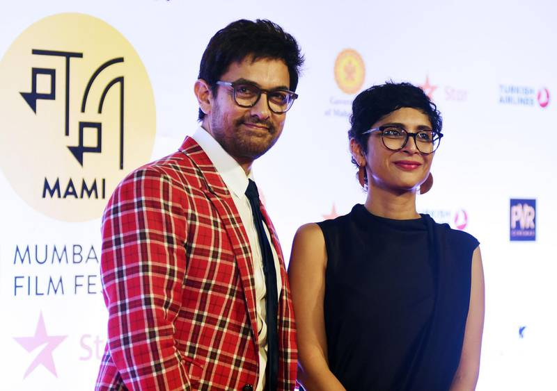 Indian Bollywood actor Aamir Khan and film producer and wife Kiran Rao attend the opening ceremony of the Jio MAMI 20th Mumbai Film Festival 2018, in Mumbai on October 25, 2018. (Photo by Sujit Jaiswal / AFP)