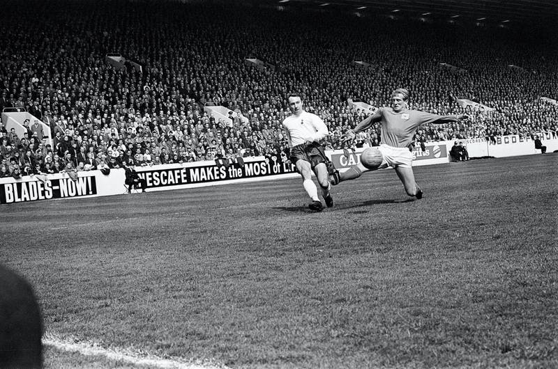 FA Cup Semi Final match at Hillsborough. Tottenham Hotspur 2 v Nottingham Forest 1. Forest midfielder Johnny Barnwell lunges valiantly but ' prevent Jimmy Greaves from delivering a cross during 2-1 FA Cup semi-final victory. Greaves relished facing Forest for the simple reason that usually he found the net against them. During his career he netted 29 times against the Reds, who suffered from his brilliant marksmanship more than any other club, 29th April 1967. (Photo by Ernest Chapman and John Varley/Mirrorpix/Getty Images)