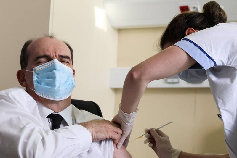 Prime Minister Jean Castex, 55-years-old, reacts as he is vaccinated with the AstraZeneca Covid-19 vaccine at the Hopital d'Instruction des Armees Begin, in Saint-Mande, on the outskirts of Paris, on March 19, 2021. Prime Minister Jean Castex, 55-years-old, is due to be given the vaccine on March 19, 2021, to boost confidence in the jab after the European medicine watchdog ruled it was safe to use. France's health authority recommended that only people aged 55 and over should be given the AstraZeneca Covid-19 vaccine due to reports of blood clots, while giving the green light to resume its use after a brief suspension. / AFP / POOL / THOMAS COEX