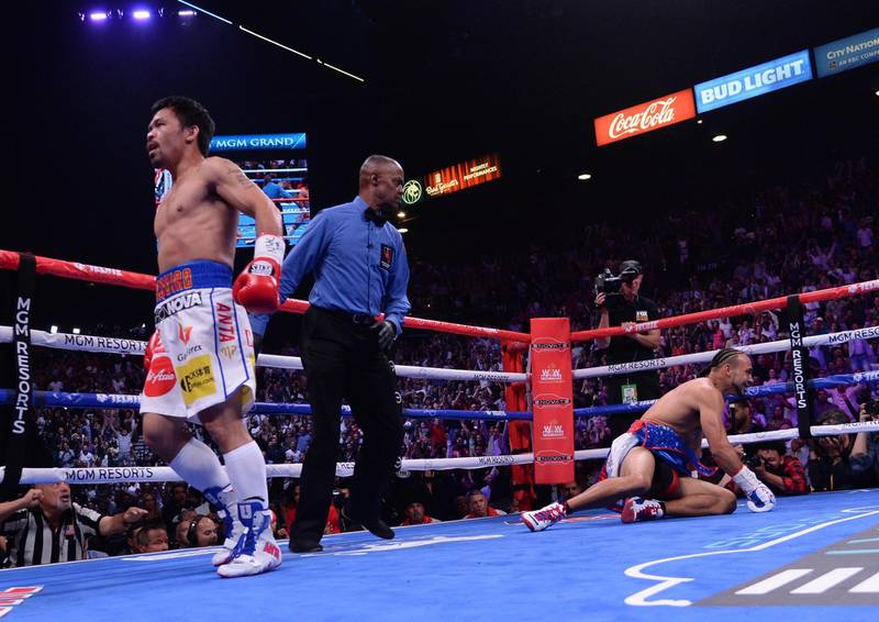Jul 20, 2019; Las Vegas, NV, USA; Manny Pacquiao (white trunks) and Keith Thurman (red/white/blue trunks) box during their WBA welterweight championship bout at MGM Grand Garden Arena. Mandatory Credit: Joe Camporeale-USA TODAY Sports