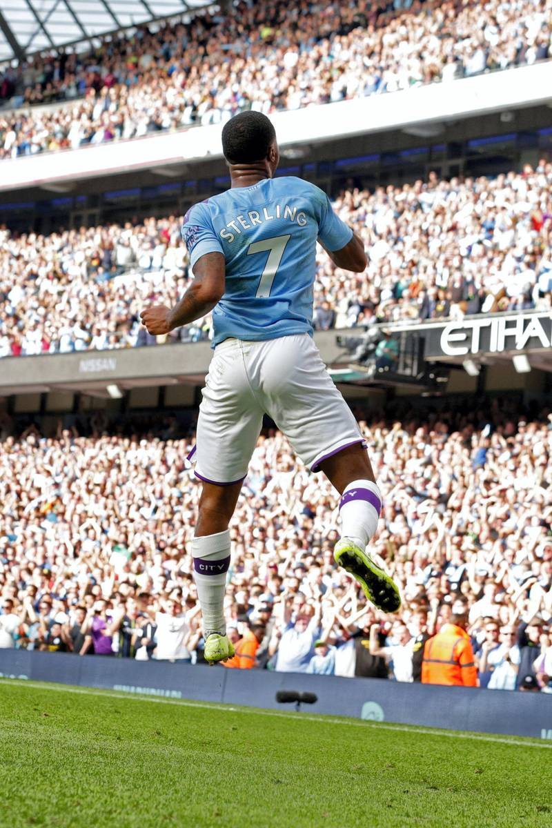 Manchester City's English midfielder Raheem Sterling celebrates scoring his team's first goal during the English Premier League football match between Manchester City and Tottenham Hotspur at the Etihad Stadium in Manchester, north west England, on August 17, 2019. (Photo by Lindsey Parnaby / AFP) / RESTRICTED TO EDITORIAL USE. No use with unauthorized audio, video, data, fixture lists, club/league logos or 'live' services. Online in-match use limited to 120 images. An additional 40 images may be used in extra time. No video emulation. Social media in-match use limited to 120 images. An additional 40 images may be used in extra time. No use in betting publications, games or single club/league/player publications. /