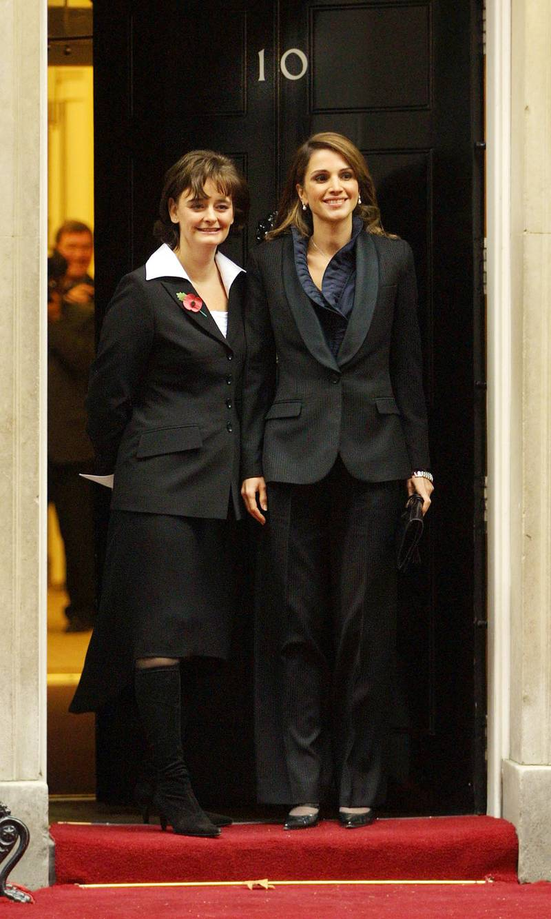 397031 02: (UK OUT) Cherie Blair (L), the wife of British Prime Minister Tony Blair greets Queen Rania of Jordan on the steps of No.10 Downing Street ahead of a meeting between their respective husbands over the current war against terrorism November 8, 2001 in London. (Photo by Jonathan Evans/BWP Media/Getty Images)