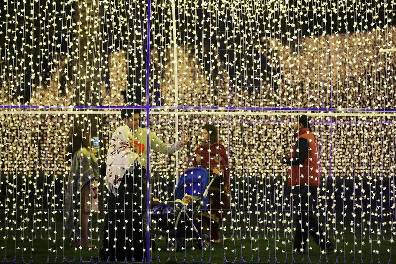 SHARJAH , UNITED ARAB EMIRATES , FEB 7 – 2018 :- People at the Palm Oasis near Al Noor Masjid during the Sharjah Light Festival in Sharjah.  (Pawan Singh / The National) For News.