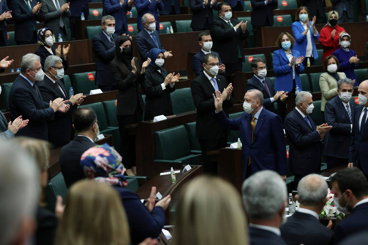 Turkish President Tayyip Erdogan greets members of his ruling AK Party during a meeting at the parliament?in Ankara, Turkey, December 23, 2020. Presidential Press Office/Handout via REUTERS ATTENTION EDITORS - THIS PICTURE WAS PROVIDED BY A THIRD PARTY. NO RESALES. NO ARCHIVE.