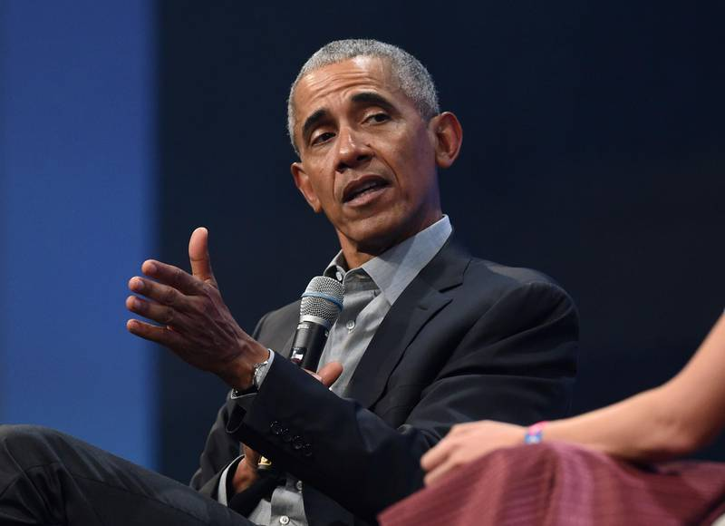 """(FILES) In this file photo taken on September 29, 2019, former US President Barack Obama speaks during the """"Bits & Pretzels"""" start-ups and founder congress in Munich, Germany.  Obama has launched a scathing attack on Donald Trump's handling of the coronavirus pandemic, calling it an """"absolute chaotic disaster."""" In a leaked web call may 8, 2020 with former members of his administration, Obama also said the Justice Department's decision to drop charges against Michael Flynn, the former Trump national security adviser who pleaded guilty to lying to the FBI in the Russia probe, endangers the rule of law in the US. / AFP / Christof STACHE"""