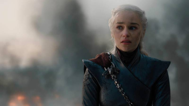"""This image released by HBO shows Emilia Clarke in a scene from """"Game of Thrones,"""" that aired Sunday, May 12, 2019. Daenerys has reduced King's Landing to ashes in a dramatic, heart-stopping episode of Game of Thrones, but don't count the city out. Despite the horrifying death and destruction, the city is likely to rebound, over time, and will probably reclaim its glory as the wealthy capital of Westeros. (HBO via AP)"""