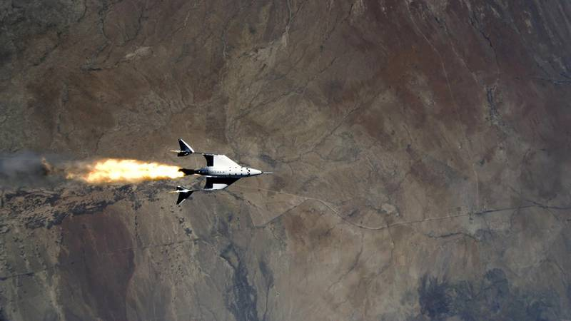 Virgin Galactic's VSS Unity, piloted by CJ Sturckow and Dave Mackay, starts its engines after release from its mothership, VMS Eve, on the way to its first spaceflight after launch from Spaceport America, New Mexico, U.S. May 22, 2021 in a still image from video. Virgin Galactic/Handout via REUTERS.  NO RESALES. NO ARCHIVES. THIS IMAGE HAS BEEN SUPPLIED BY A THIRD PARTY.