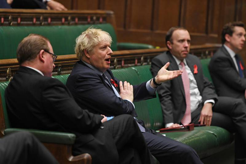Britain's Prime Minister Boris Johnson speaks during a session on COVID-19 situation update at the House of Commons in London, Britain December 1, 2020.  UK Parliament/Jessica Taylor/Handout via REUTERS  THIS IMAGE HAS BEEN SUPPLIED BY A THIRD PARTY. MANDATORY CREDIT. IMAGE MUST NOT BE ALTERED
