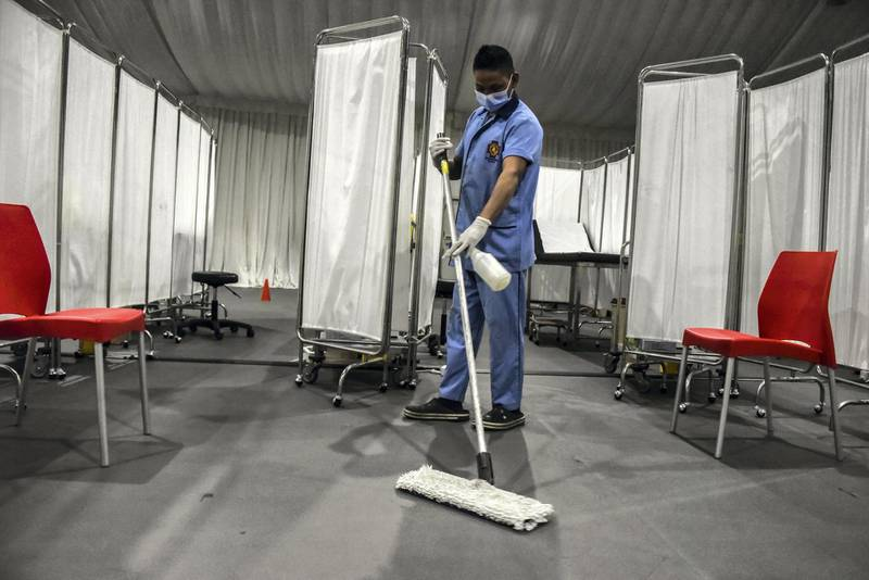 Beirut, Lebanon, 13 February, 2021. A janitor disinfects surfaces and floors as a new vaccine center is set up at St George's hospital, on the eve of Lebanons Covid-19 vaccine roll-out. Lebanon is preparing to receive its first, Pfizer-Biontech Covid-19 vaccines.