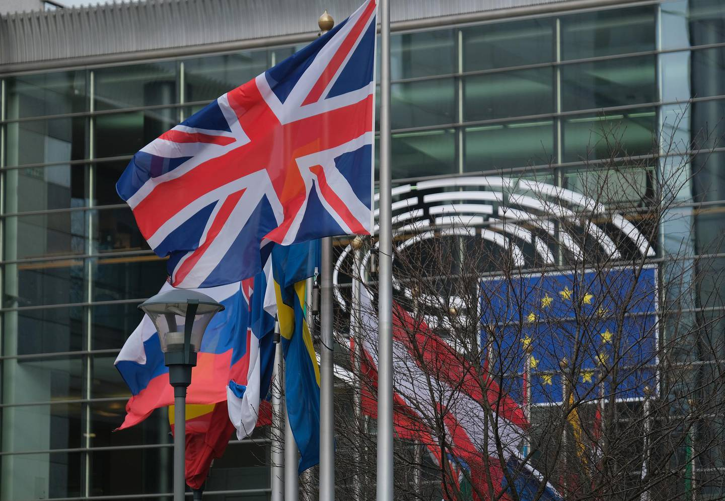 BRUSSELS, BELGIUM - JANUARY 30: The British flag flies among flags of member states of the European Union outside the European Parliament on January 30, 2020 in Brussels, Belgium. The day before the Parliament ratified the Brexit agreement, which will allow the United Kingdom to leave the EU tomorrow at midnight with a legislative framework agreed on between the two entities.  (Photo by Sean Gallup/Getty Images)