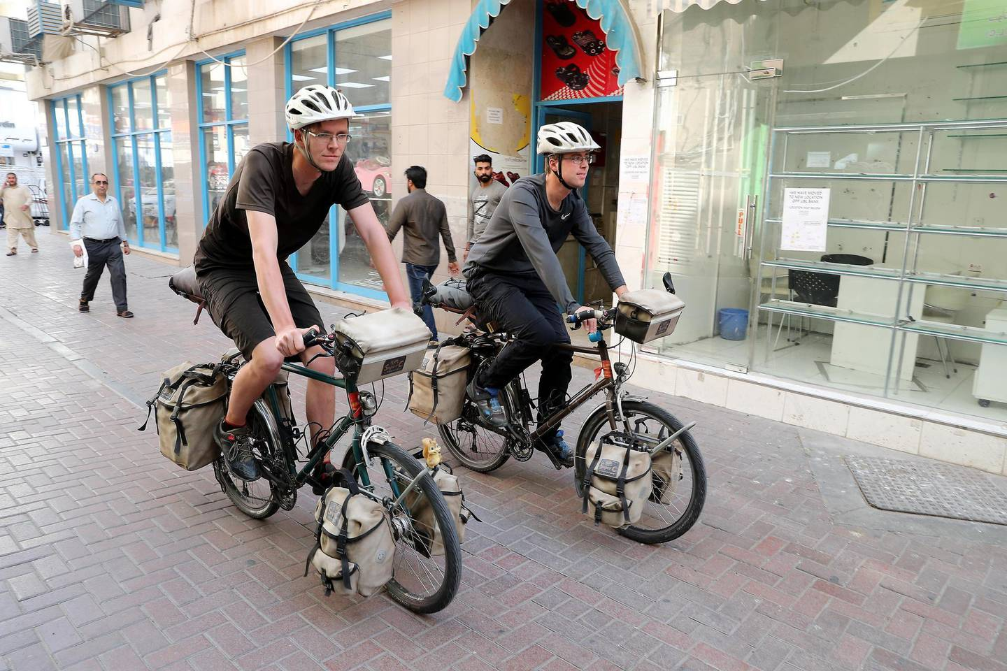 DUBAI , UNITED ARAB EMIRATES , February 07 – 2019 :- Left to Right – Dominik Fischer and Simon Helmecke on their bicycles outside their Royal Creek hotel in Deira in Dubai. They are cycling around the world. ( Pawan Singh / The National ) For News. Story by Patrick
