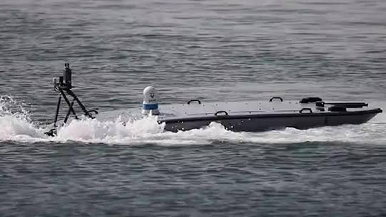 An image that illustrates this article US Navy tests unmanned speedboats that can launch 'nano drones' in Arabian Sea