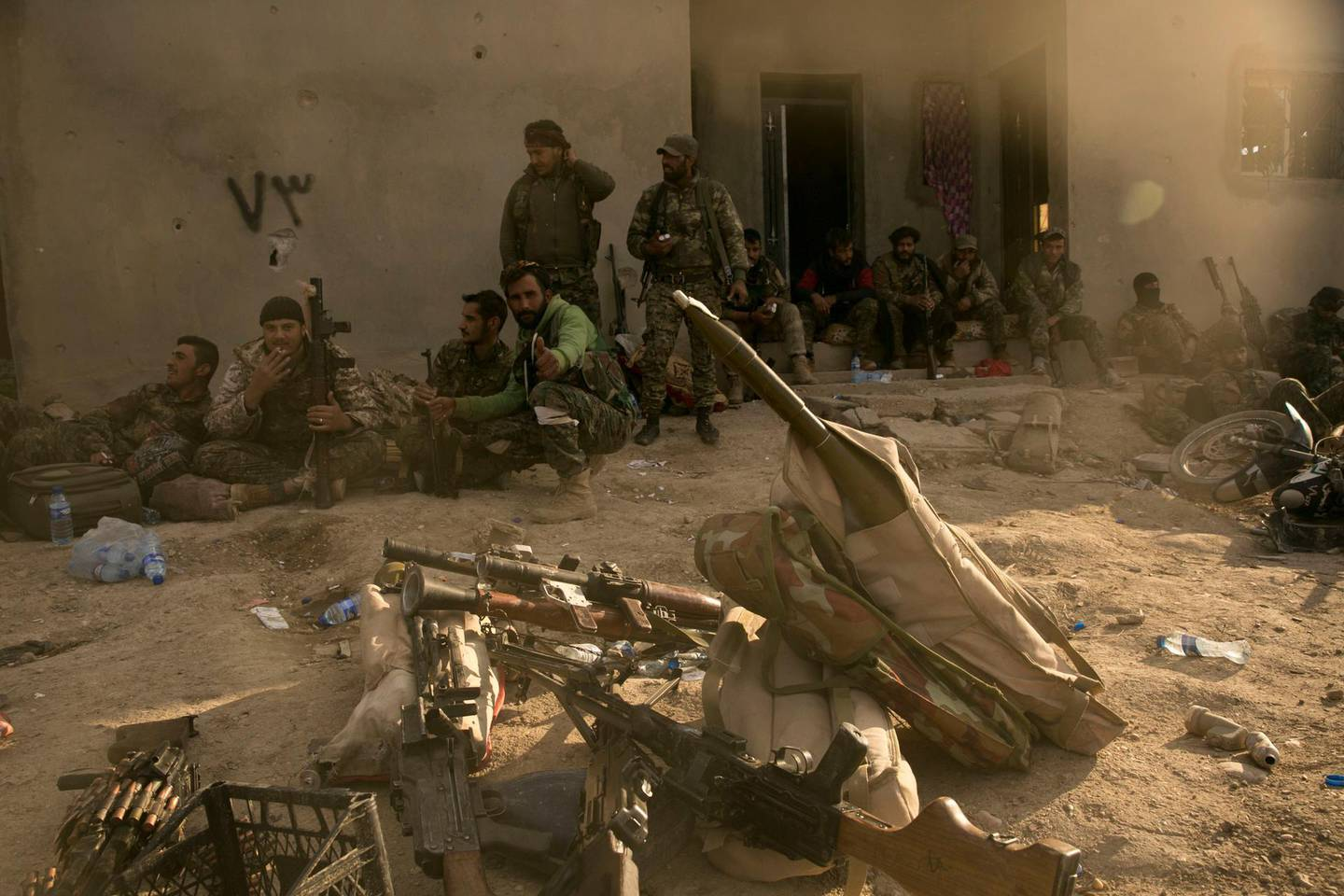 U.S.-backed Syrian Democratic Forces (SDF) fighters rest after returning from the front line after territorial gains over Islamic State militants in Baghouz, Syria, Tuesday, March 19, 2019.  On Tuesday, a spokesman for U.S.-backed forces fighting IS in Syria says his fighters are in control of an encampment in the village of Baghouz where IS militants have been besieged for months. (AP Photo/Maya Alleruzzo)