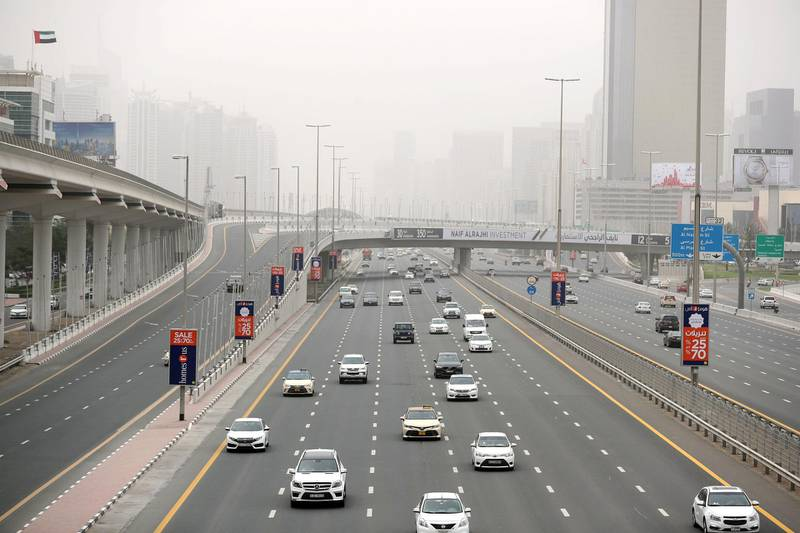 Dubai, United Arab Emirates - March 25, 2019: Hazy weather over Sheikh Zayed Road and the Marina. Mponday the 25th of March 2019 in Dubai. Chris Whiteoak / The National