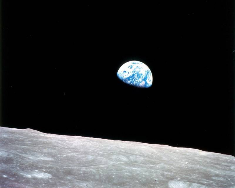 """Apollo 8, the first manned mission to the moon, entered lunar orbit on Christmas Eve, Dec. 24, 1968. That evening, the astronauts-Commander Frank Borman, Command Module Pilot Jim Lovell, and Lunar Module Pilot William Anders-held a live broadcast from lunar orbit, in which they showed pictures of the Earth and moon as seen from their spacecraft. Said Lovell, """"The vast loneliness is awe-inspiring and it makes you realize just what you have back there on Earth."""" They ended the broadcast with the crew taking turns reading from the book of Genesis.Image Credit: NASA"""