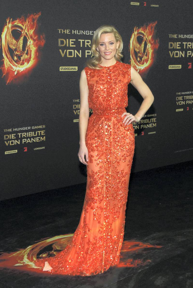 """BERLIN, GERMANY - MARCH 16:  Actress Elizabeth Banks attends the """"The Hunger Games"""" ('Die Tribute von Panem') Germany Premiere at the Cinestar movie theater on March 16, 2012 in Berlin, Germany.  (Photo by Anita Bugge/Getty Images)"""