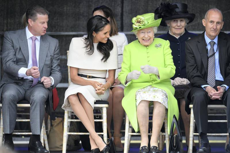 WIDNES, CHESHIRE, ENGLAND - JUNE 14:  Queen Elizabeth II laughs with Meghan, Duchess of Sussex during a ceremony to open the new Mersey Gateway Bridge on June 14, 2018 in the town of Widnes in Halton, Cheshire, England. Meghan Markle married Prince Harry last month to become The Duchess of Sussex and this is her first engagement with the Queen. During the visit the pair will open a road bridge in Widnes and visit The Storyhouse and Town Hall in Chester.  (Photo by Jeff J Mitchell/Getty Images)