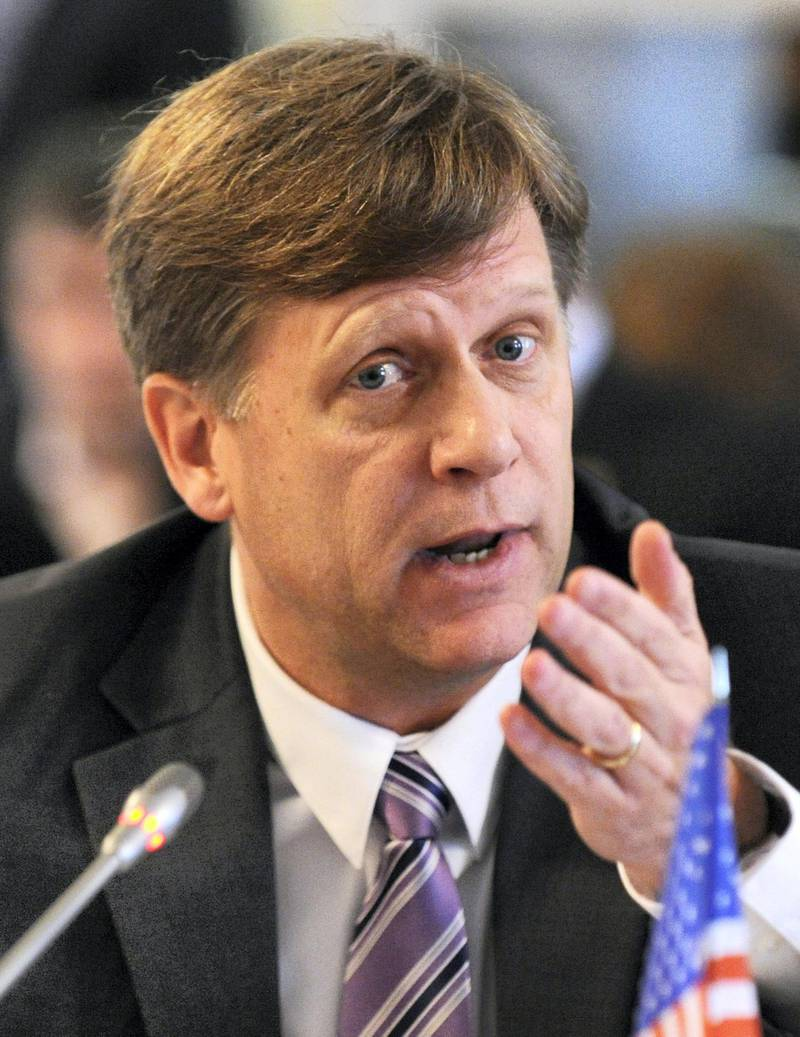 US ambassador to Russia, Michael McFaul, speaks as he takes  part in a round table discussion on NGO cooperation between the two countries  in Moscow, on April 4, 2013. AFP PHOTO / YURI KADOBNOV / AFP PHOTO / YURI KADOBNOV