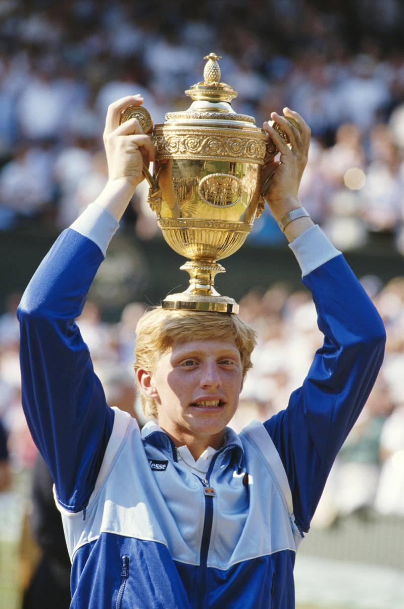 Boris Becker of Germany places the trophy on his head in to celebrate his defeat of Kevin Curren 6-3, 6-7 (4-7), 7-6 (7-3), 6-4 during the Men's Singles final of the Wimbledon Lawn Tennis Championship on 7th July 1985 at the All England Lawn Tennis and Croquet Club in Wimbledon in London, England. It was Becker's 1st career Grand Slam title and his 1st Wimbledon title. (Photo by Steve Powell/Getty Images)