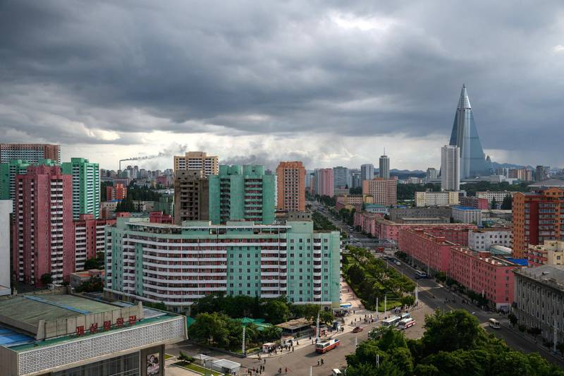 A photo taken on June 15, 2018 shows the Ryugyong Hotel in the distance of this general view of the Pyongyang's skyline.  Donald Trump dangled the carrot of foreign investment in front of North Korean leader Kim Jong Un at their nuclear summit, but analysts say few will want to put money into one of the highest-risk business environments in the world. / AFP PHOTO / Ed JONES / TO GO WITH AFP STORY: NKorea-Economy-Diplomacy-Nuclear; Focus by Sebastien BERGER