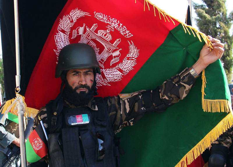 epa07780281 An Afghan soldier marks the Independence Day in Helmand, Afghanistan, 19 August 2019.  Afghanistan is celebrating the 100th anniversary of its independence from British rule on 19 August.  EPA/WATAN YAR