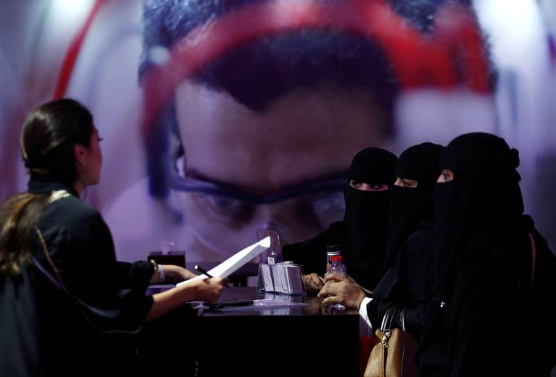 Saudi job seekers talk to a company representative at Glowork Women's Career Fair in Riyadh, Saudi Arabia October 2, 2018. REUTERS/Faisal Al Nasser