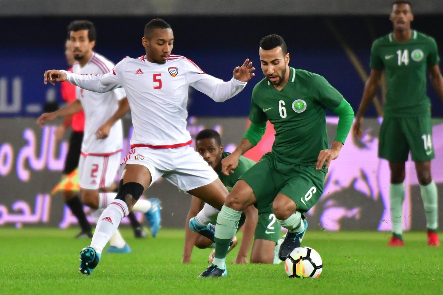 Saudi's Nooh Al-Mousa (2-R) vies for the ball with Emirates' Ali Salmeen al-Bloushi during the 2017 Gulf Cup of Nations football match between UAE and Saudi Arabia at the Sheikh Jaber al-Ahmad Stadium in Kuwait City on December 25, 2017. / AFP PHOTO / GIUSEPPE CACACE
