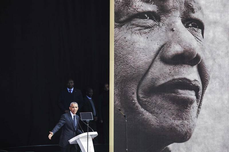 Former US President Barack Obama speaks during the 2018 Nelson Mandela Annual Lecture at the Wanderers cricket stadium in Johannesburg on July 17, 2018. Former US president Barack Obama will deliver the Nelson Mandela Annual Lecture, urging young people to fight to defend democracy, human rights and peace, to a crowd of 15,000 people at the club as the centrepiece of celebrations marking 100 years since Nelson Mandela's birth. Obama has made relatively few public appearances since leaving the White House in 2017, but he has often credited Mandela for being one of the great inspirations in his life.  / AFP / GIANLUIGI GUERCIA