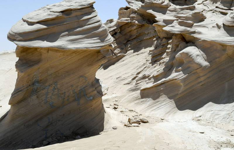 Abu Dhabi, United Arab Emirates - Graffiti vandalism near the entrance of the ancient rock formations attraction in the outskirts desert area, at Al Wathba. Khushnum Bhandari for The National