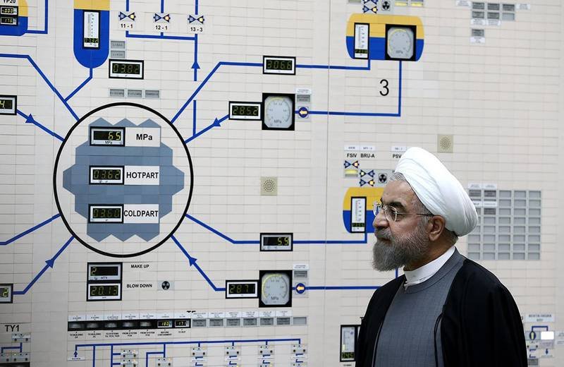 """(FILES) In this file photo taken on January 13, 2015 and released by the official website of the Iranian President Hassan Rouhani shows him visiting the control room of the Bushehr nuclear power plant in the Gulf port city of Bushehr. Iran's President Hassan Rouhani on September 4, 2019 ordered all limits on nuclear research and development to be lifted, the country's third step in scaling down its commitments to a 2015 deal with world powers. / AFP / Iranian Presidency / MOHAMMAD BERNO / RESTRICTED TO EDITORIAL USE - MANDATORY CREDIT """"AFP PHOTO / IRANIAN PRESIDENCY WEBSITE / MOHAMMAD BERNO """" - NO MARKETING NO ADVERTISING CAMPAIGNS - DISTRIBUTED AS A SERVICE TO CLIENTS"""