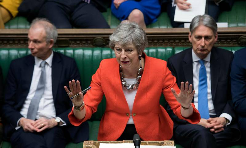 """FILE - In this Tuesday March 12, 2019 file photo Britain's Prime Minister Theresa May speaks to lawmakers in parliament, London. Britain's love-hate relationship with the rest of Europe goes back decades, but the Brexit crisis gripping it today stems from dramatic January 2013 speech by Prime Minister David Cameron in which he promised an """"in or out"""" referendum. Britain voted to leave, but negotiations between Britain and the EU have been slow and at times acrimonious, and the 585-page withdrawal agreement produced after two years of talks has been rejected twice by Britain's divided Parliament. (Jessica Taylor/UK Parliament via AP, File)"""