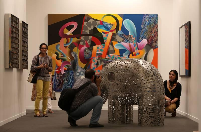 DUBAI , UNITED ARAB EMIRATES Ð  Mar 21 , 2014 : Visitors looking art work in the Art Dubai 2014 at Madinat Jumeirah in Dubai. ( Pawan Singh / The National ) For Arts & Life. Story by Anna Seaman