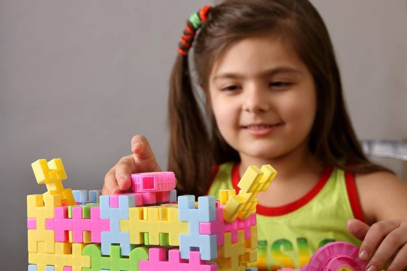 Girl playing with lego. Getty Images